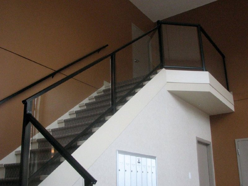 Aluminum glass stair railing inside in Vancouver area